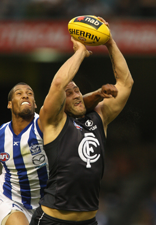 2009 Rd 1 NAB Cup - Outstretched Fevola marks in front of Gibson.